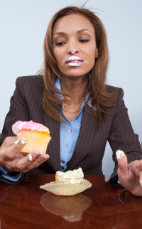 Woman hoeing into cupcake