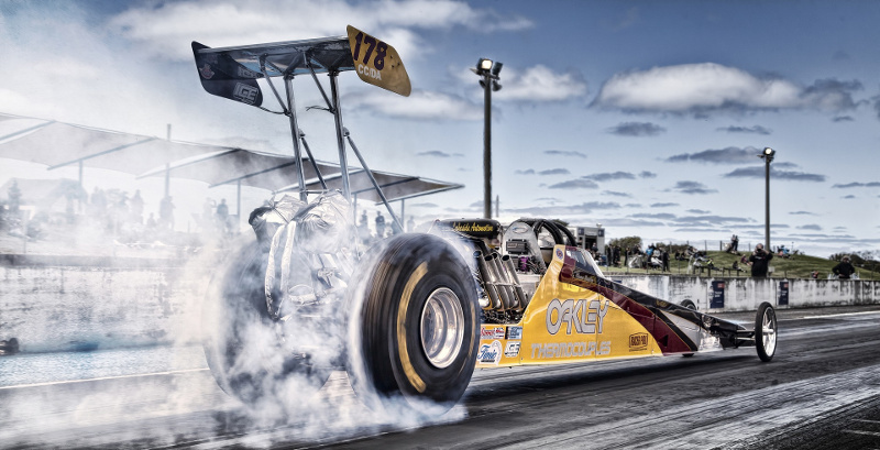 Drag racer spinning its wheels