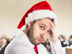 Man showing stress of Christmas